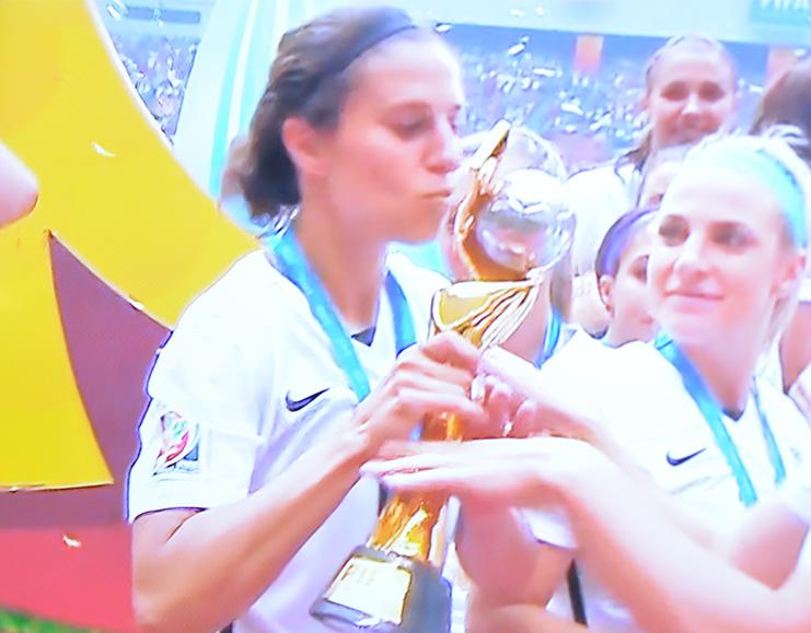 Carli kissing the Trophy