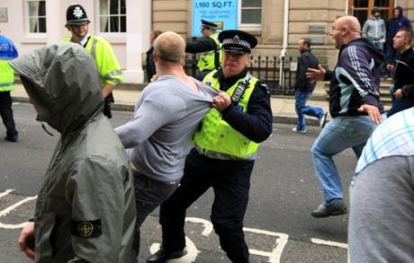 Police arresting police