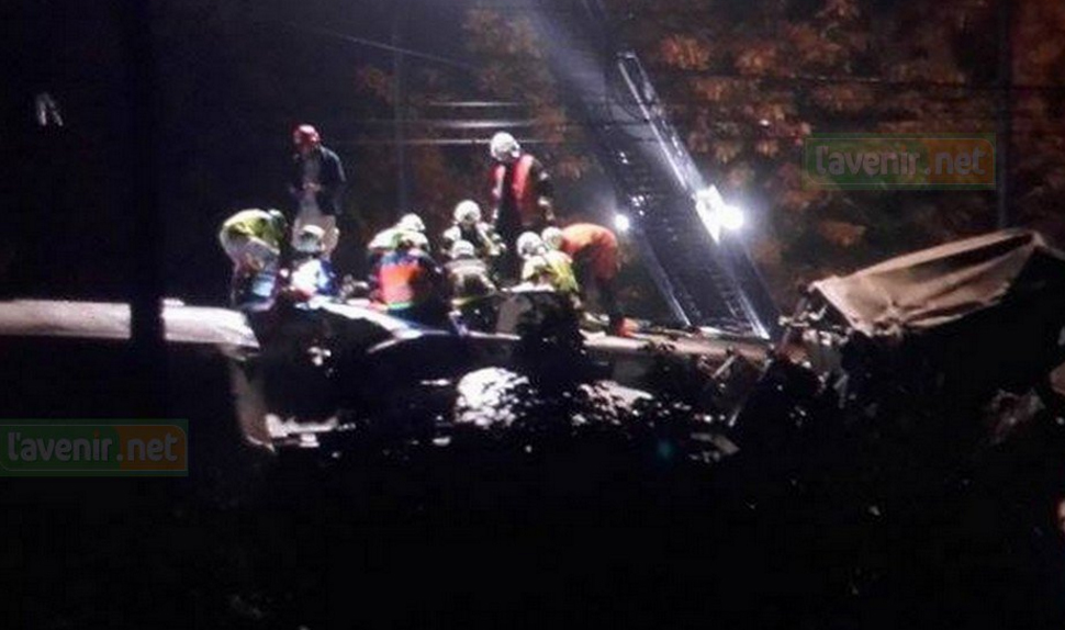 Rescue workers at the Belgium train crash wreckage