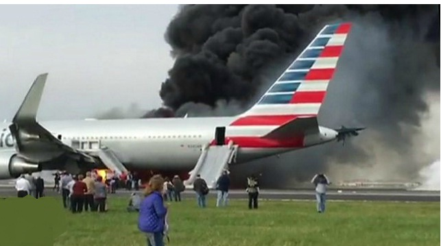 Smoke bellowing out of American Airlines