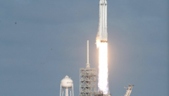 Flacon lifts off with Elon Musk's red Teslar