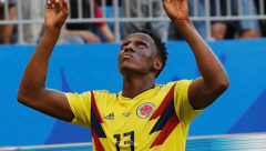 Mina header propels Columbia to last 16