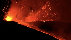 Mount Etna erupts and lights up the night sky