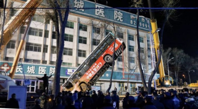 A sinkhole which opened up in the bus stop in Xining, North west China kills six