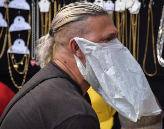 A vendor in Sao Paulo with makeshift mask against coronavirus