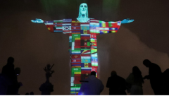 The statue of Christ the Redeemer is lit up in the colors of the countries that are affected by the coronavirus disease (COVID-19) outbreak in Rio de Janeiro