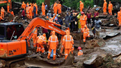 Rescue workers sifting through rubble after landslide