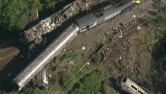 Three dead after train hit landslide and derails