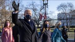 Biden-Harris walking down the Pennsylvania Avenue to the White House