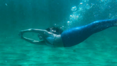 Kate MacLeod mermaid swimming in the locs of Western Isles