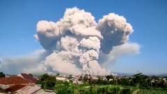Mount Sinabaug erupts