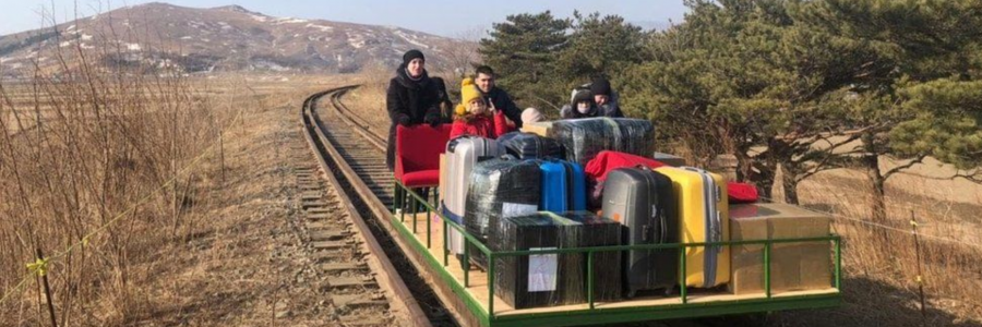 Russian Diplomats exiting North Korea by hand pushed trolley