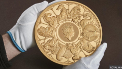 The gold coin featuring 10 creatures which appeared in stone statues on the Queen's route to her coronation