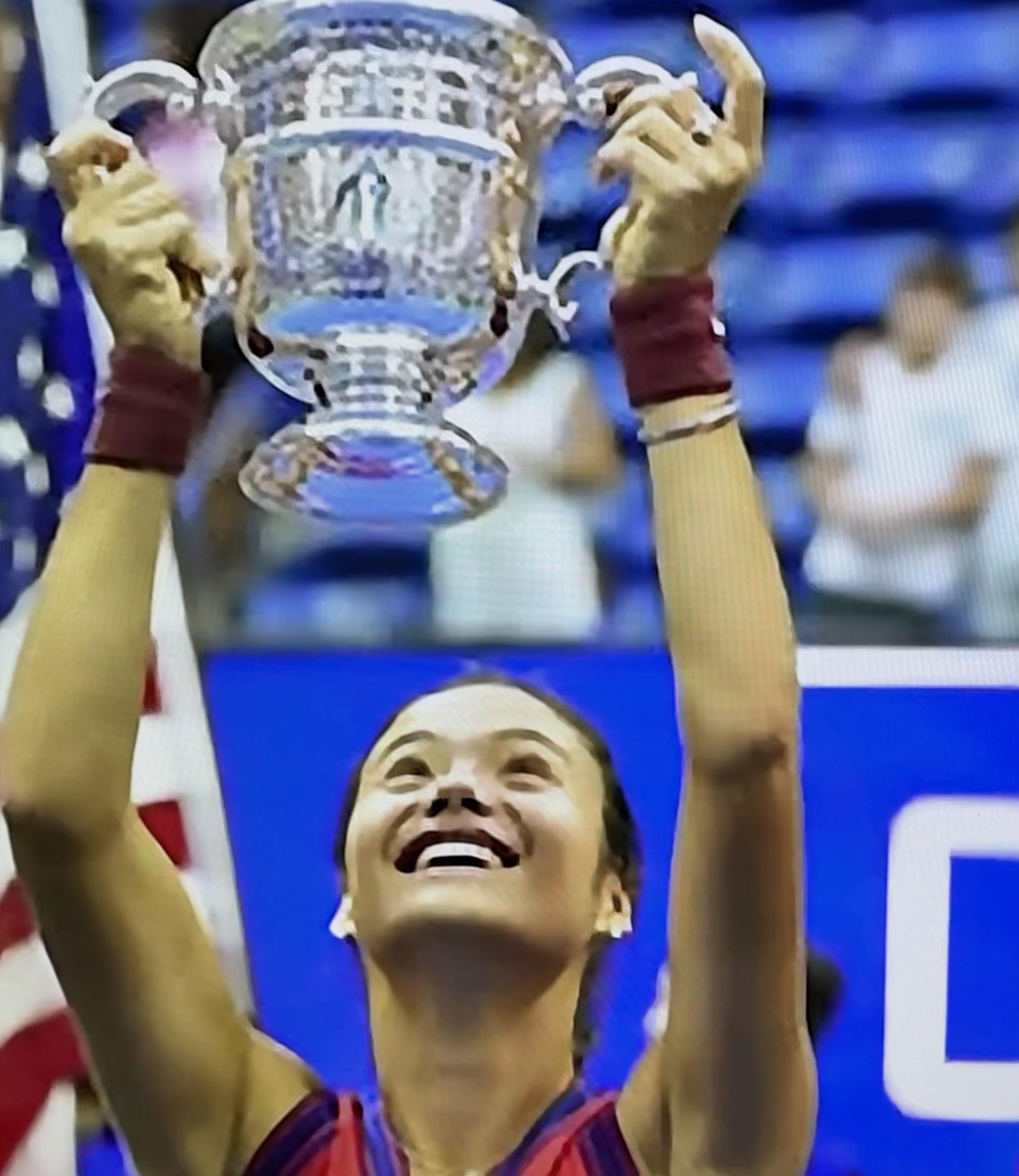 Emma Raducanu lifting the coveted US Open trophy