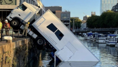 A HGV truck carrying costumes for BBC is half submerged in the Bristol Harbour